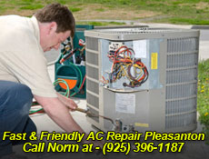 repairman servicing an HVAC unit